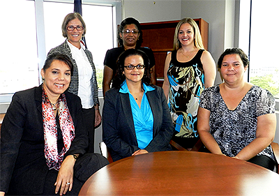 Front row, left to right: Chief Officer for Education Mrs. Mary Rodrigues, Minister for Education Hon. Tara Rivers and ECCE's new Senior Policy Advisor & Manager Mrs. Carol Bennett. Back row, left to right: Outgoing Manager of ECCE Ms Julie Madgwick and ECCE Officers Mrs. Reneé Barnes and Mrs. April Tibbetts.