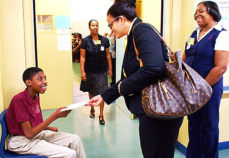 A student greets Education Minister Tara Rivers at the Lighthouse School Open House By Janice MacLean