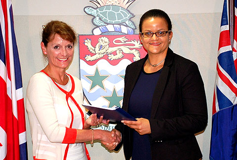 Her Excellency the Governor Helen Kilpatrick, CB accepts the CEDAW Request from Minister of Gender Affairs, Hon. Tara Rivers.