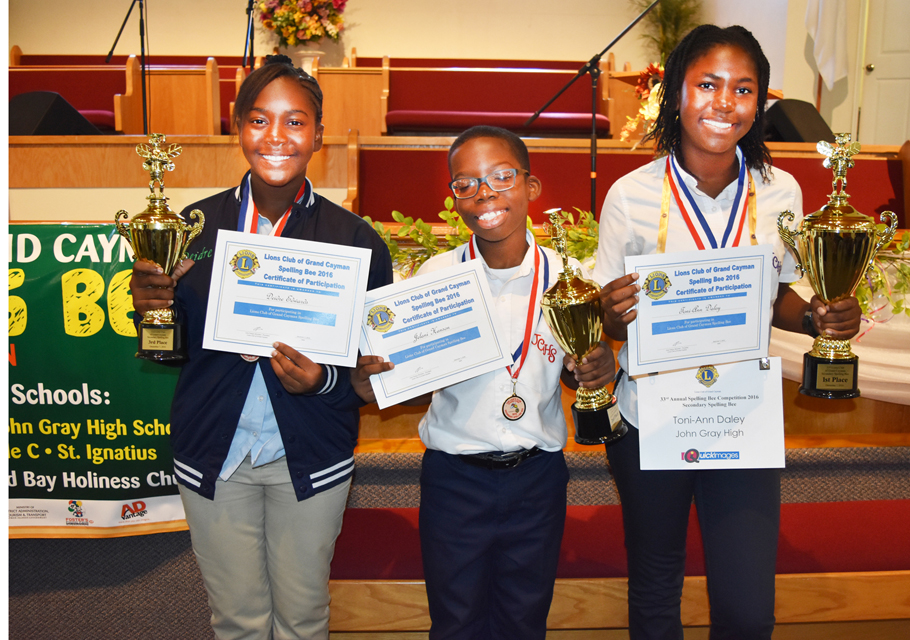 Third place winner, Deirdre Edwards; second place winner Jelani Hanson; first place winner Toni-Ann Daley.