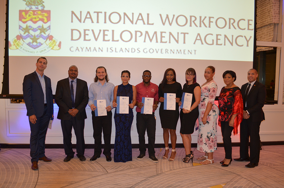 Christian Esser (WineSchool3); Christen Suckoo(Chief Officer, MEEGA), Graduates: Samuel Taffee-Ebanks, Shirley Bodden, Leonardo Borsetto, Dovina Minzett, Candice Ebanks and Teisha Bush; Dianne Conolly (NWDA- Training Manager); Shalico Christian(WineSchool3). Missing from the picture is graduate Arianna Wheeler-Seijas.