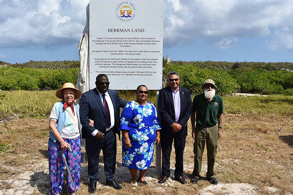 Barbara Wolfe, Minister Dwayne Seymour, Minister Juliana O'Connor-Connolly, Capt. Eugene Ebanks and Chris Randall (Chairman, National Trust Cayman Brac District Committee) in front of the plaque.