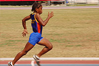 Monique Garden of Bodden Town Primary sprints towards the finish line.