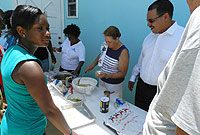 Culture Camp attendees learn how to make cassava cake.