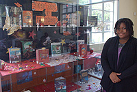 Miriam Mascal (right) and her teammate Renee Connolly (absent) won the Cayman Islands Public Library Service's book display competition. Their winning entry was titled The Art of Fantasy.