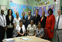 Left to Right back row: SJACPS Principal Joseph Wallace, RBPS Principal Vickie Frederick, BTPS Principal June Elliott, JGHS Principal Lyneth Monteith, Minister of Education Hon. Rolston Anglin, JP, Chief Officer Mary Rodrigues, LHS Principal Carla Macvicar, CHHS Principal Pauline Beckford, SPS Principal Brian Allen.  