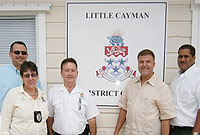 (L-R) Little Cayman – District Officer Mr. Larry Foster, and DLP Representatives.