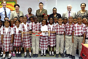 Red Bay Primary School's Year 3 class whose teacher Marsha Gay Smart (back row, far left) has been trained in the Maths Recovery Programme are joined by (back row, left to right) CISPA President James George, Chief Education Officer Shirley Wahler, Prospect Primary School Teacher who will be trained in the programme Suzette Watler-Galeano, Chief Officer Mary Rodrigues, Prospect Primary School Principal Gloria Bell, Numeracy Specialist Frank Eade and Red Bay Primary School Principal Vickie Frederick.
